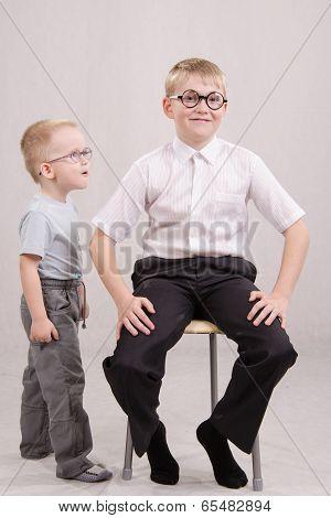 Little Boy Clings To Teens