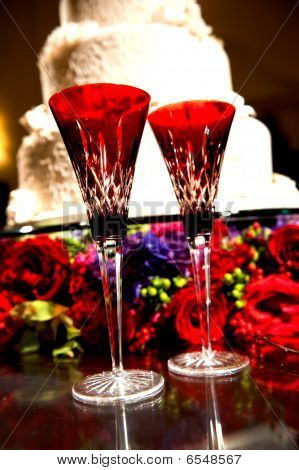 Beautiful Champagne Toasting Flutes By The Cake At A Wedding