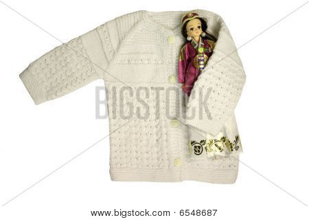 baby cardigan and doll
