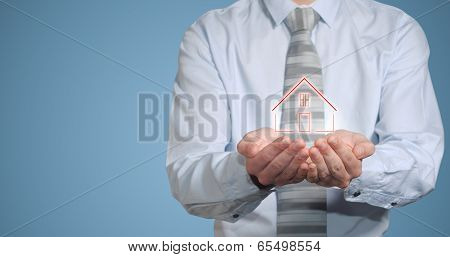 Businessman Banker Holding Home In Hands
