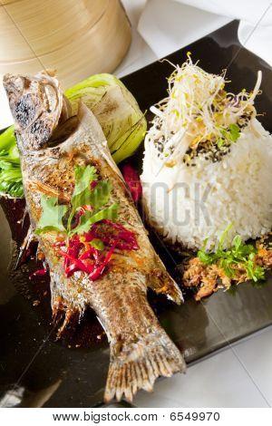 Australian Barramundi, Served With Fragrant Jasmine Rice And Wil