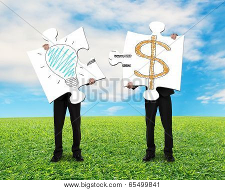 Holding 2 Puzzles With Idea Is Money Concept