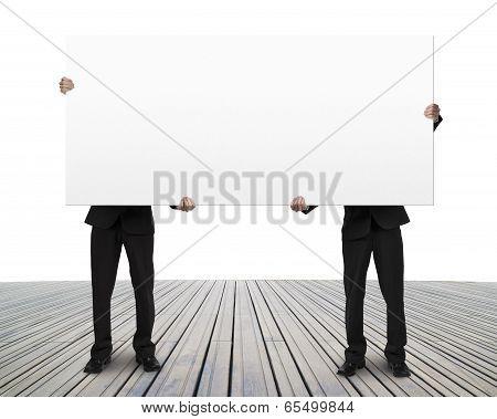 Men Holding Blank Board On Wooden Floor
