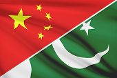 picture of pakistani flag  - Flags of China and Islamic Republic of Pakistan blowing in the wind - JPG