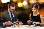 stock photo of couple  - restaurant - JPG