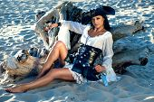 foto of pirate girl  - Portrait of a pirate woman at the beach - JPG