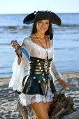 picture of pirate girl  - Portrait of a pirate woman at the beach - JPG