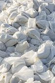 picture of sandbag  - Big pile of sandbags for disaster protection - JPG