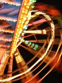 image of funfair  - colourful blur of night - JPG