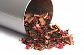 pic of brew  - Dried loose mixed berry and green leaf tea tea spilling out of a tin ready to steep and brew on a white background - JPG