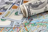 stock photo of kiev  - Roll of money on the map Kiev - JPG