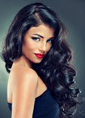 image of brunette hair  - Model brunette with beautiful long curled hair and red lips - JPG