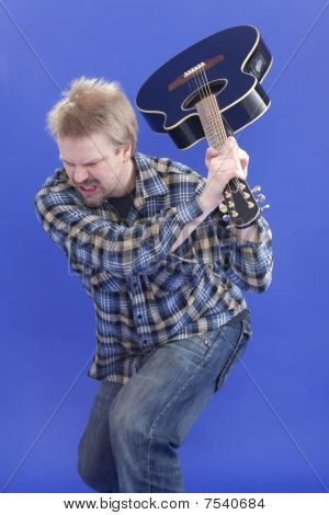 Man Is Smashing His Guitar On The Floor