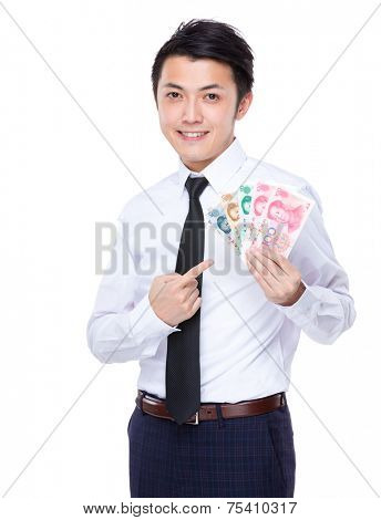 Businessman with spread of RMB