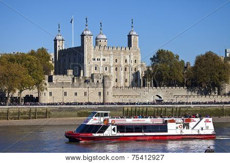 A Tourist Boat Passing The Tower Of London