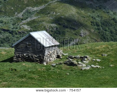 Old wooden cottage in mountains