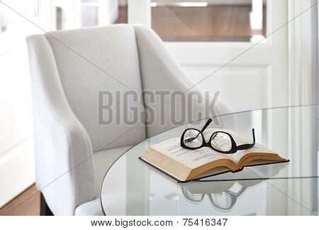 Armchair with Book and Eyeglasses on table