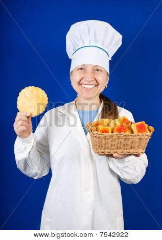 Portrait Of Female Cook With Cookie