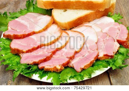 sliced bacon on a plate with bread
