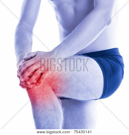 Man touches a sore knee with contusion
