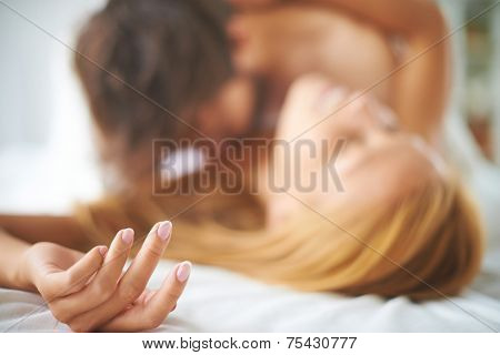 Hand of female caressed by a man