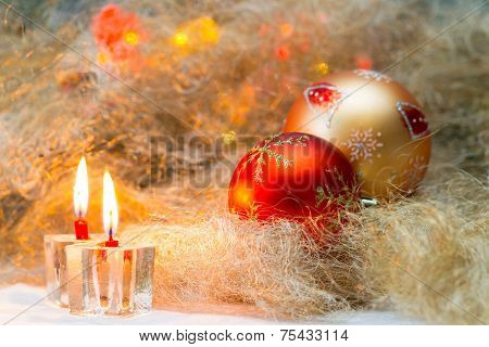 Christmas balls with candles on the background lights