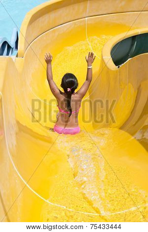 Children play on the water slide