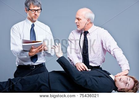 Clerks Repairing A Businessman For Fun