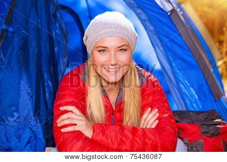 Closeup portrait of happy smiling camper girl sitting in the tent, active lifestyle, autumn adventure, discovering world, travel and tourism concept
