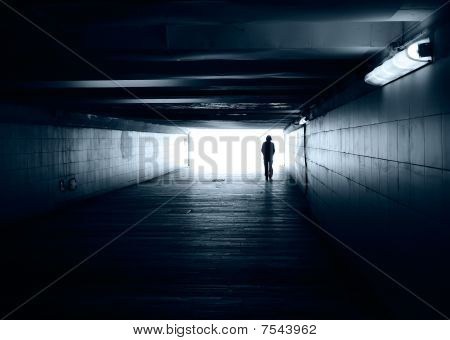 Lonely Silhouette In A Subway Tunnel