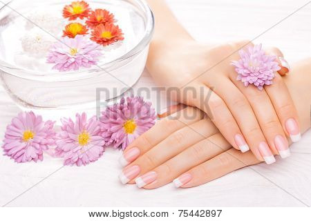 Beautiful French Manicure On White Wooden Table