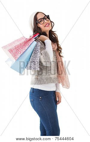 Brunette with glasses holding shopping bags on white background