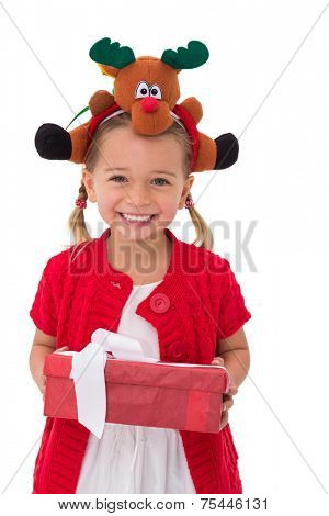 Cute little girl wearing rudolph headband on white background