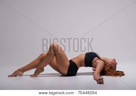 Woman gymnast stretching