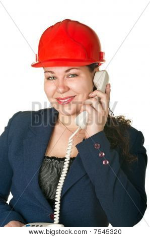 Young Woman Architect In Red Helmet Calling By Phone. Isolated On White Background