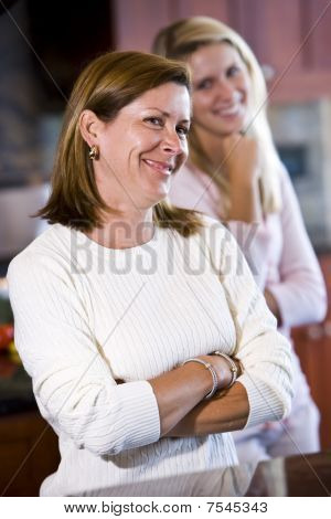 Closeup Of Mother In Kitchen With Teenage Daughter