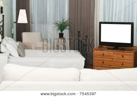 The big TV in a bedroom