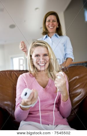 Pretty Teenage Girl Playing Video Games At Home