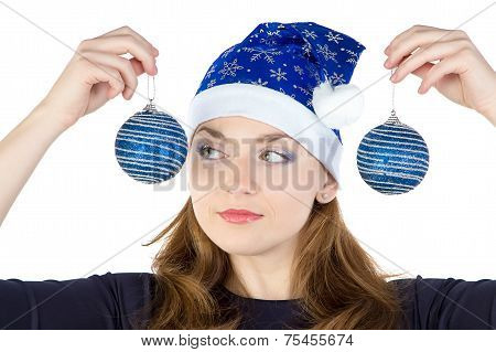 Photo of young woman looking at christmas balls