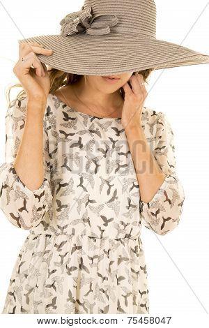 Woman Birds On Dress Eyes Hid Behind Hat