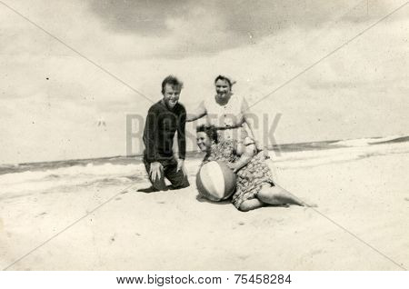 POLAND, CIRCA FIFTIES: Vintage photo of people enjoying beach