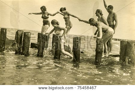 POLAND, CIRCA FORTIES: Vintage photo of people playing on remains of breakwater