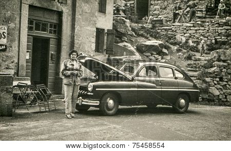 MONTE CARLO, MONACO, CIRCA AUGUST 1957: Vintage photo of woman and old car