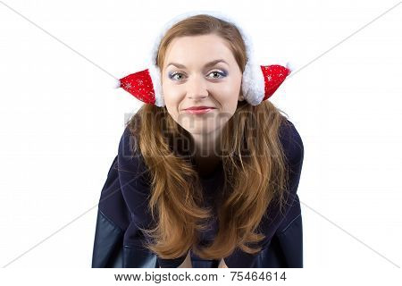 Portrait of happy young woman in winter headphones