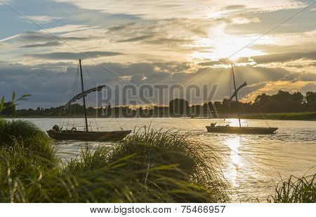 Two Traditional Boats On The Loire With Sunset