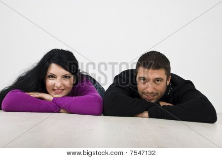 Smiling Couple Lying On Floor
