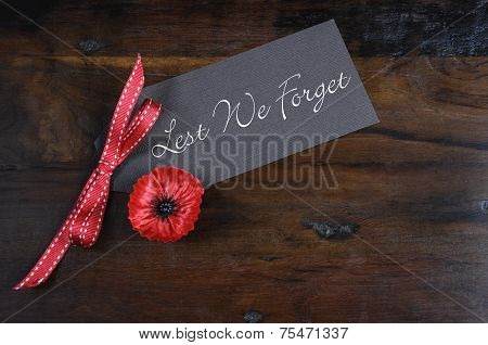 Lest We Forget, Red Flanders Poppy Lapel Pin Badge For November 11, Remembrance Day Appeal, On Dark