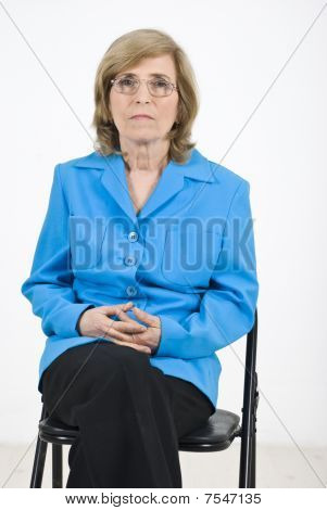 Senior Woman Waiting On Chair