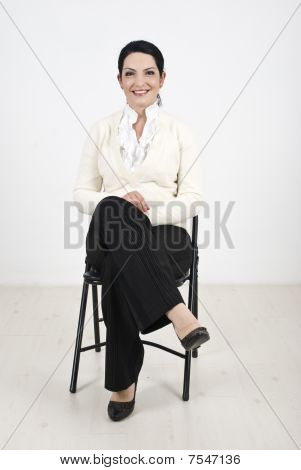 Business Woman Sitting On Chair