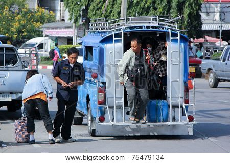 CHIANGMAI , THAILAND - OCTOBER 19 2014: Driver and Passenger of Pink mini truck taxi, Service betwee